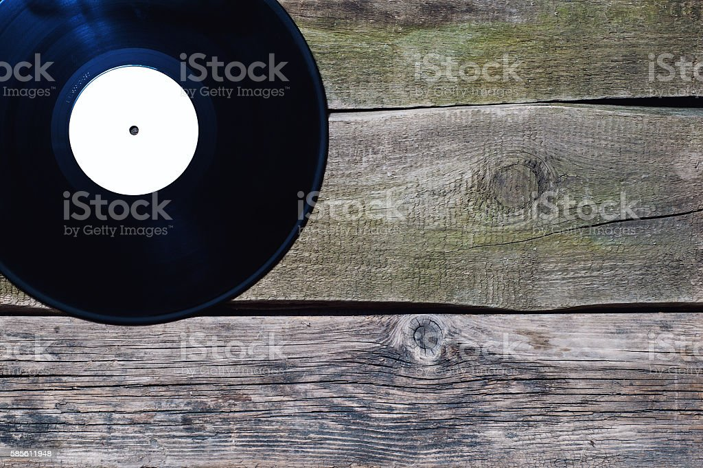 vinyl record with white label on the old vintage floor stock photo