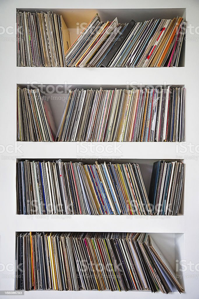 Vinyl records collection in custom wall shelves stock photo