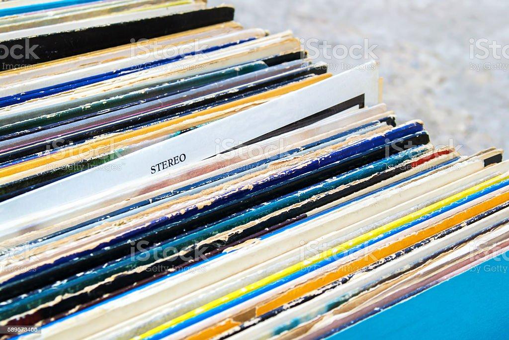 Vinyl records in box closeup. Stereo sign stock photo