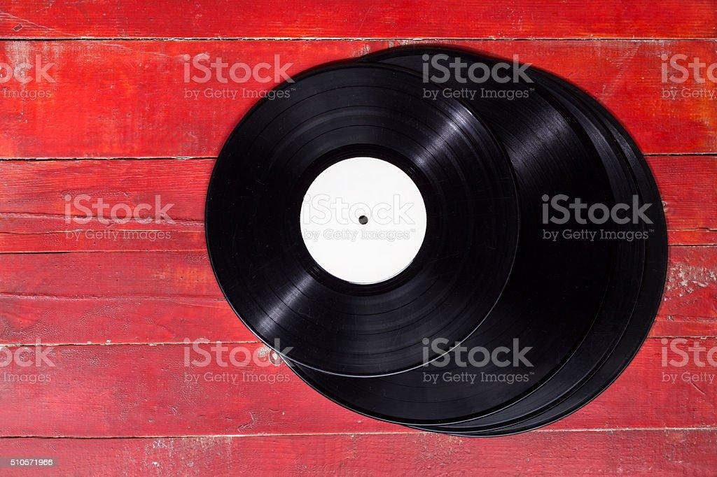 Vinyl records on wooden surface. stock photo