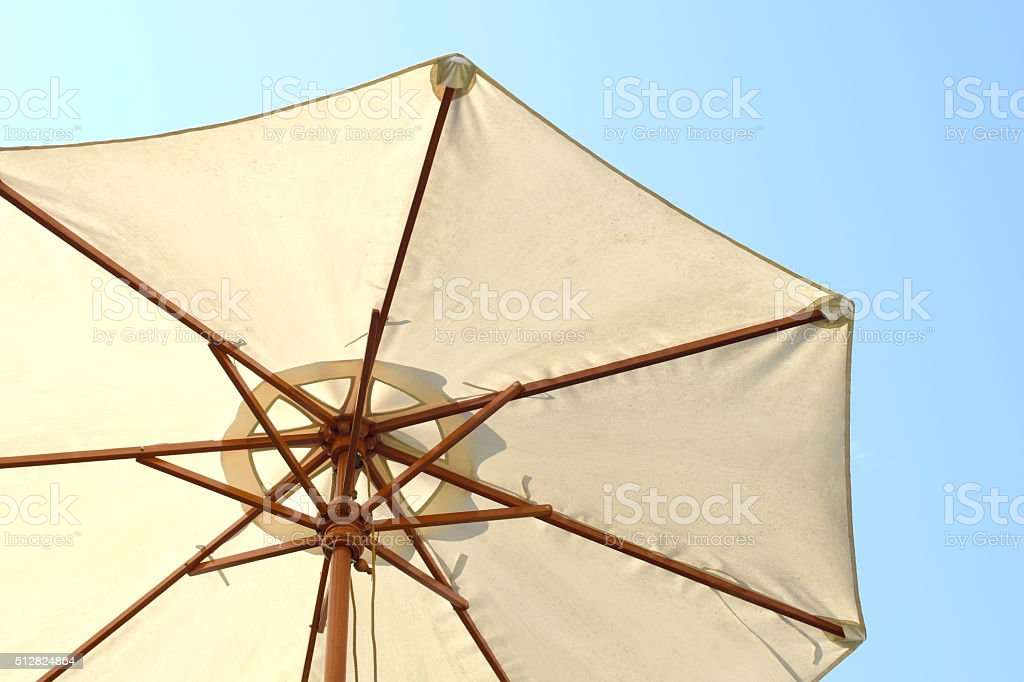 Vinyl umbrella with wooden structure stock photo