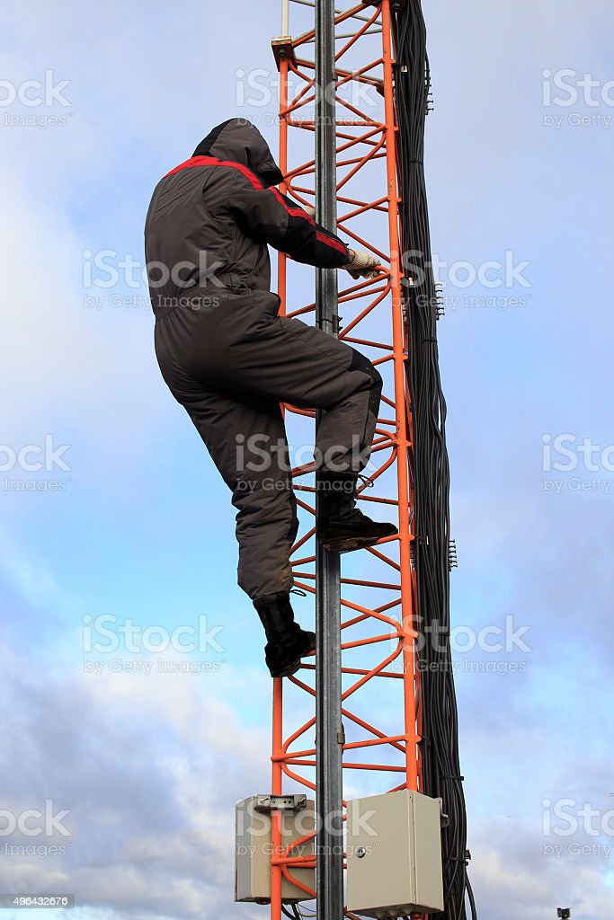violation of safety at high-altitude works stock photo