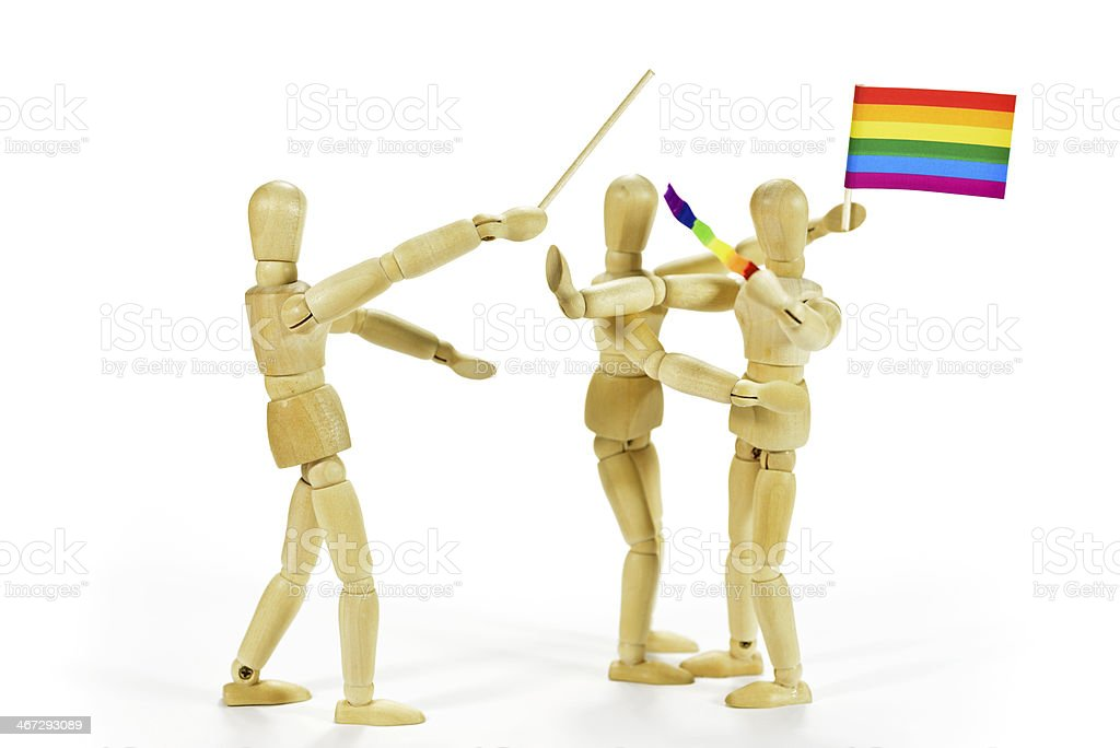 Violence against homosexuals with rainbow flag stock photo