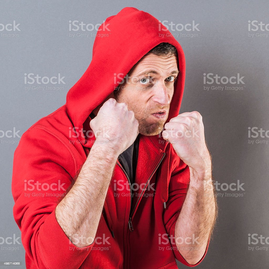 violent 40s casual man with attitude fighting like a boxer stock photo