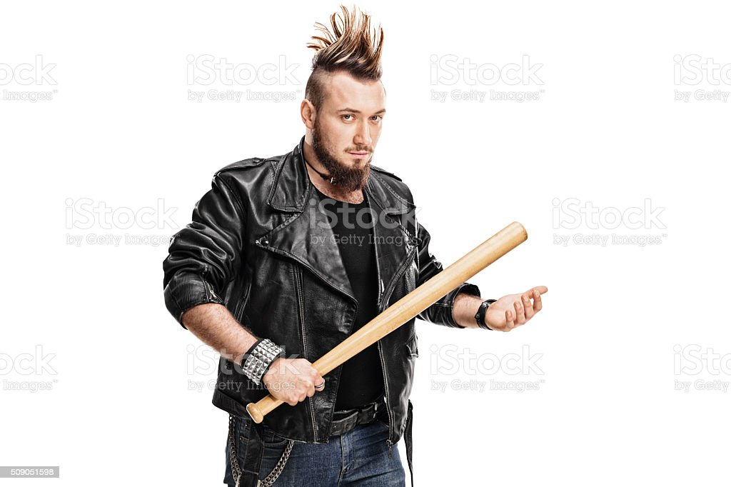 Violent punk rocker holding a baseball bat stock photo