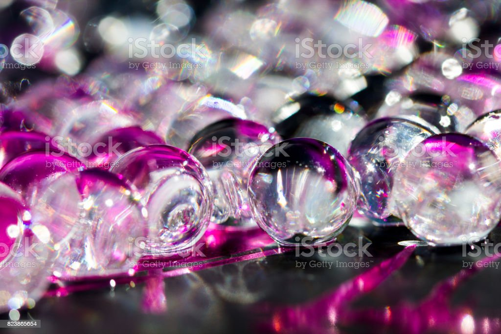 Violet and dark water gel balls. Macro photo, can be used both for advertising or cosmetics and for medicine. Abstract background. stock photo