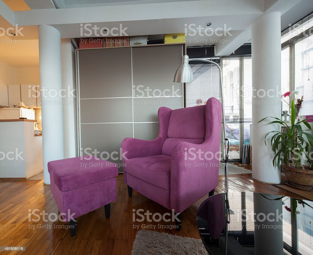 violet armchair in modern apartment interior stock photo