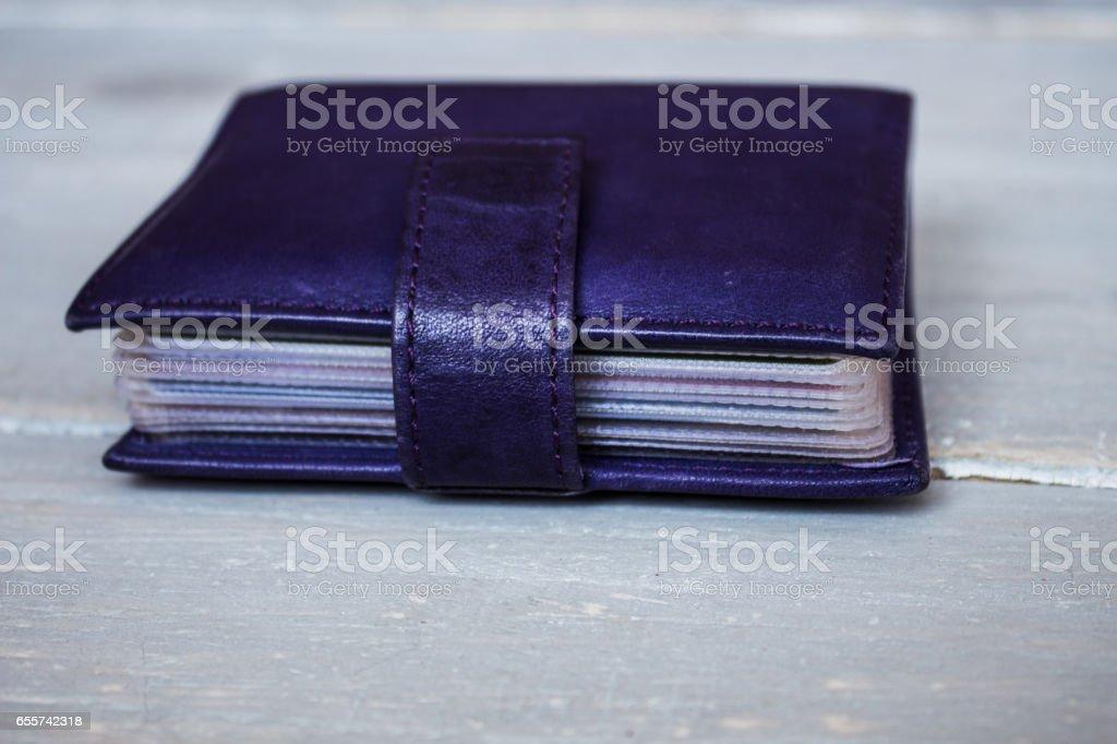 violet leather card holder stock photo