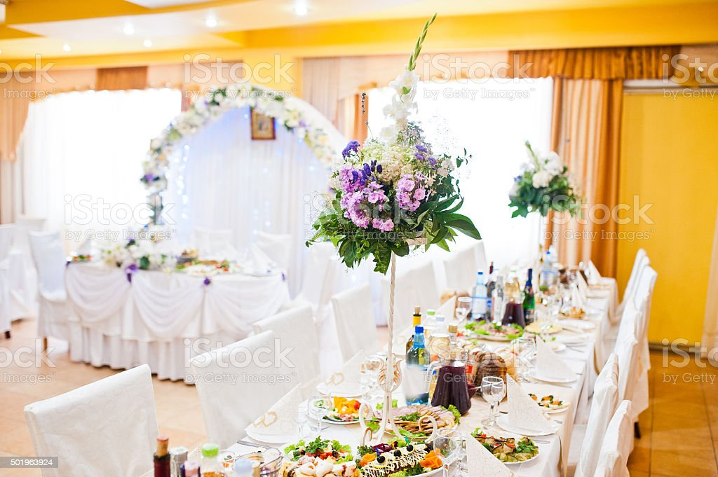 Violet lilac flowers on wedding table stock photo