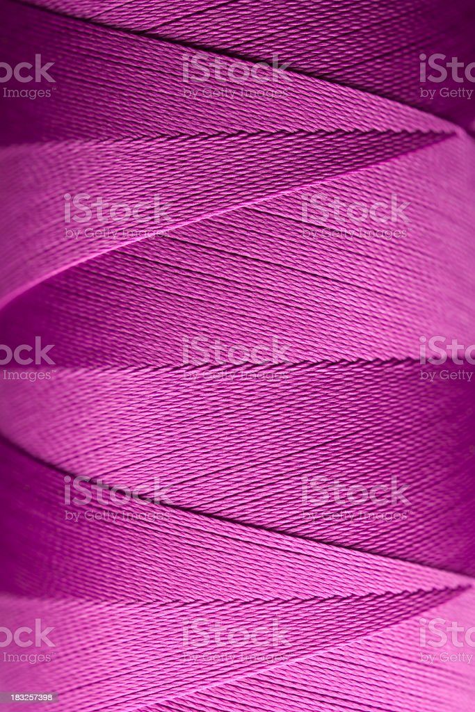 Violet spool of thread royalty-free stock photo
