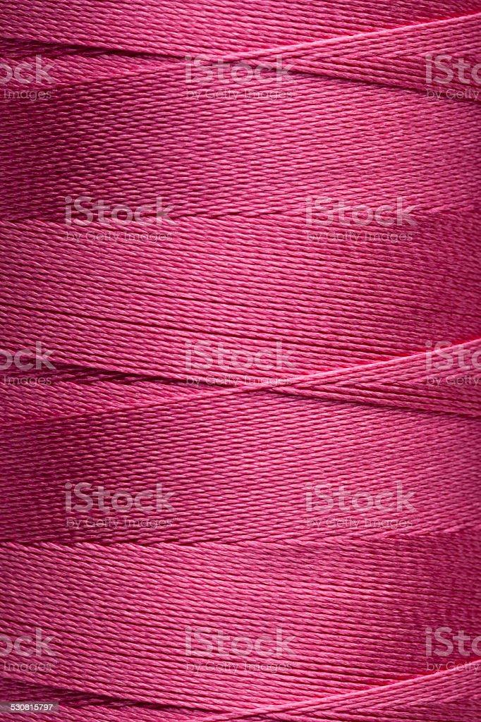 Violet spool of thread stock photo
