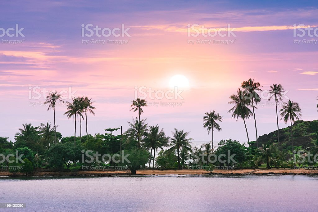 Violet sunset over remote tropical beach in Thailand stock photo