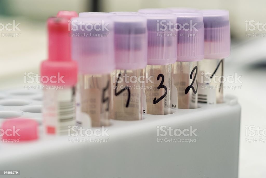 violet test tubes with numbers; royalty-free stock photo