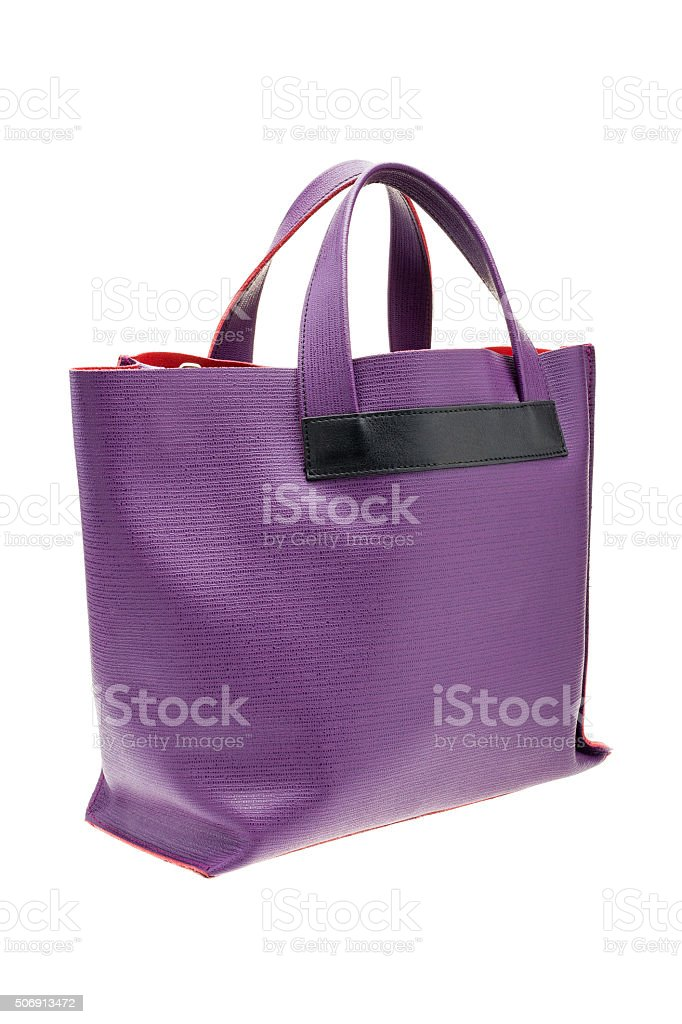 Violet womens bag isolated on white background. stock photo