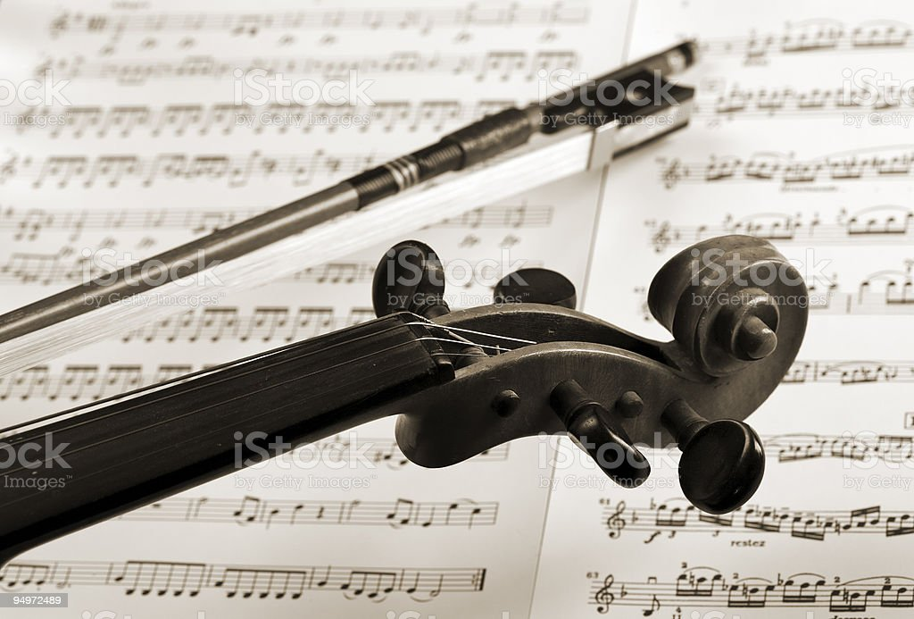 violin and bow detail on notation sheets royalty-free stock photo
