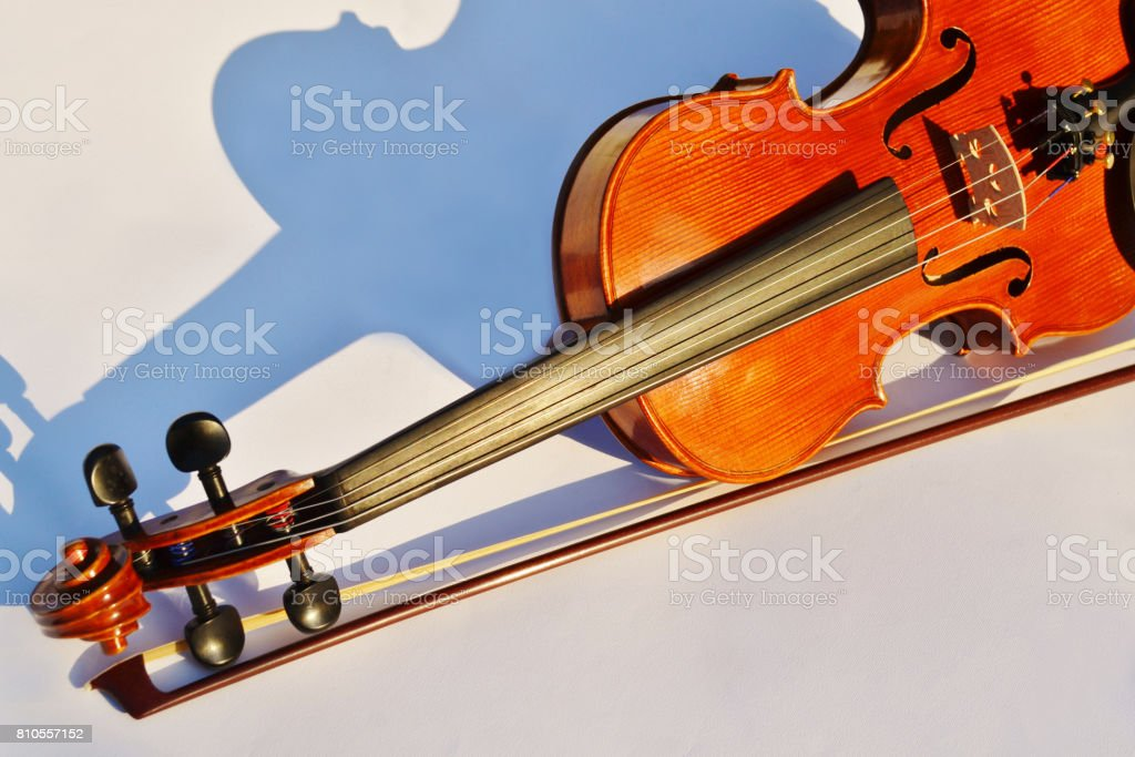 Violin and bow partial view stock photo