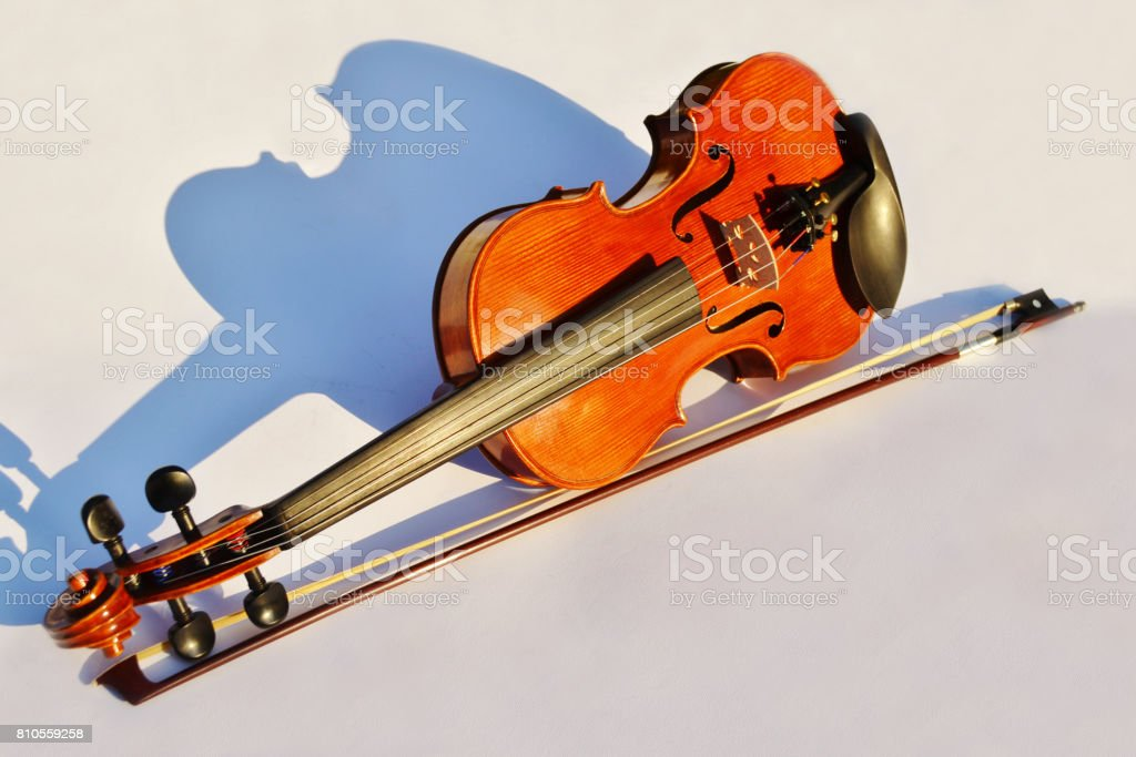 Violin and bow with moulded shadow stock photo