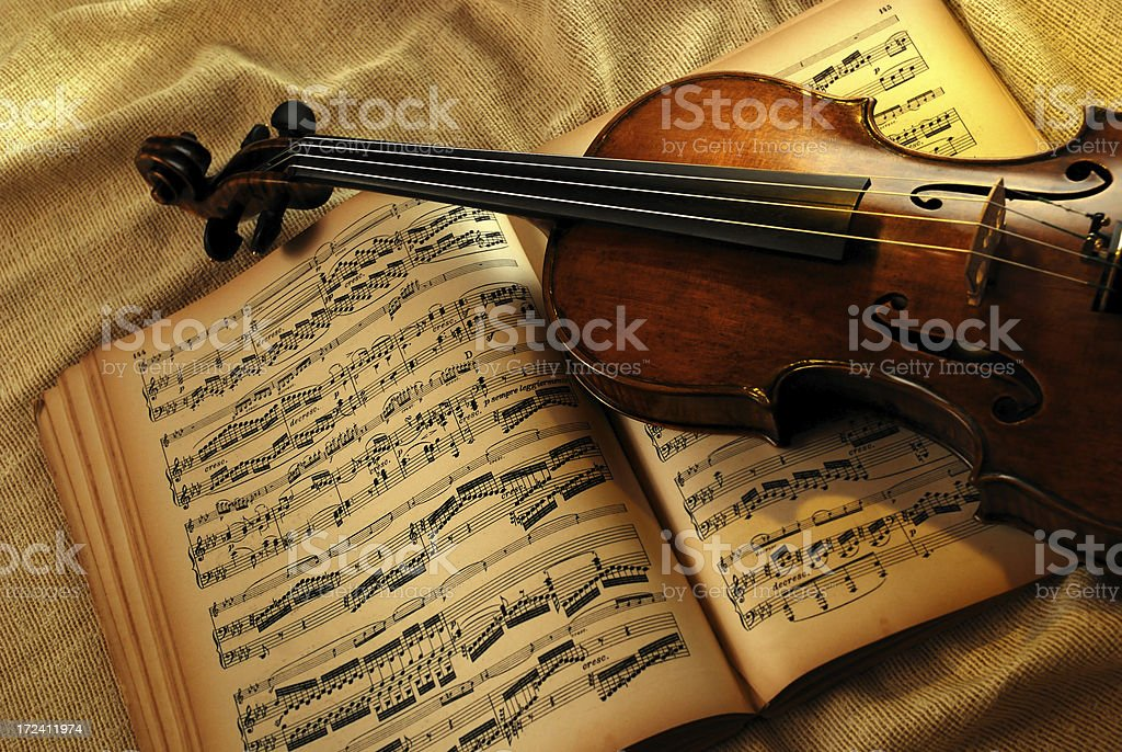 Violin and very old notes stock photo