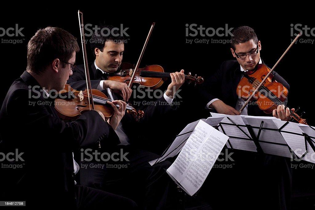 Violin and violoncello players stock photo