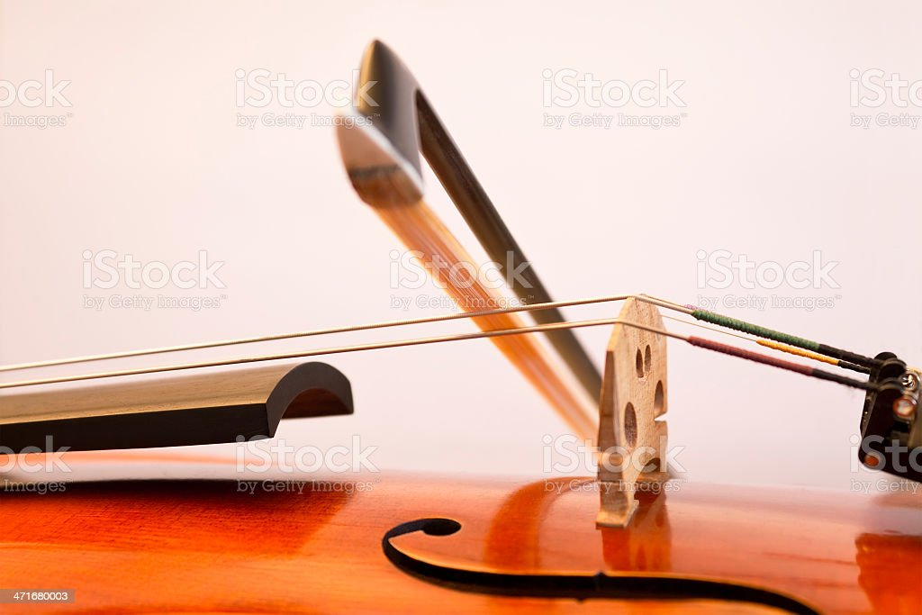Violin bow on the string royalty-free stock photo
