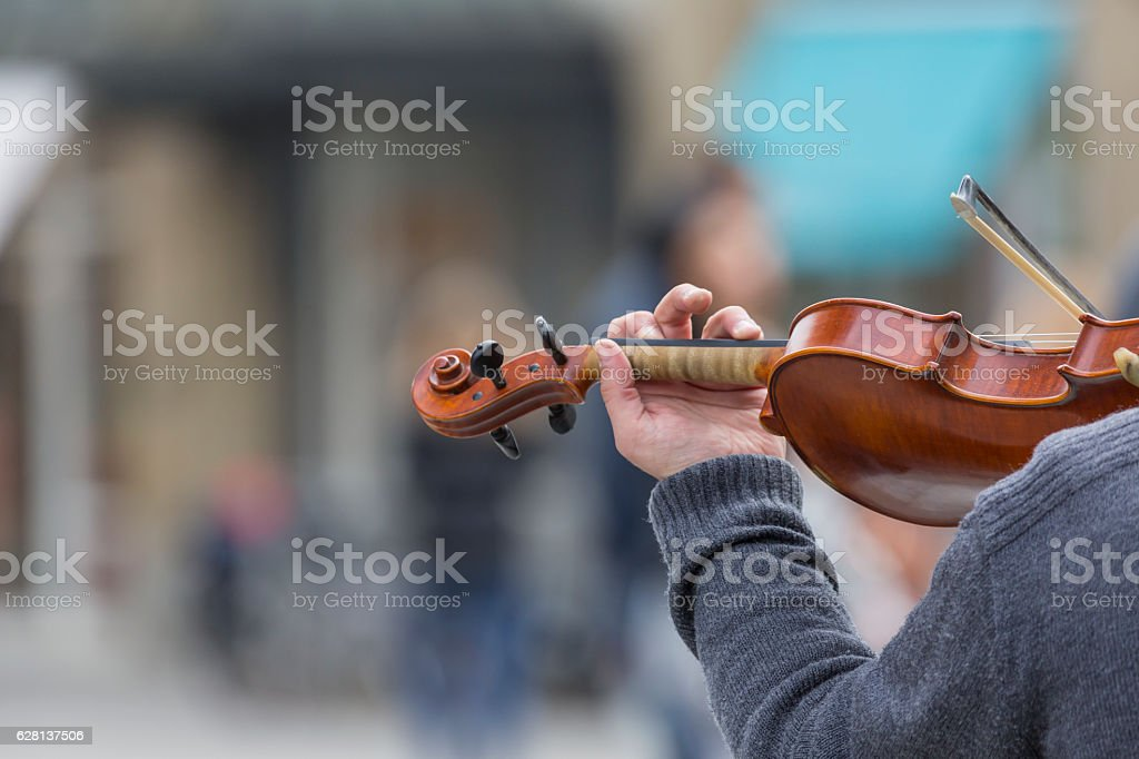 Violin close up with hand stock photo