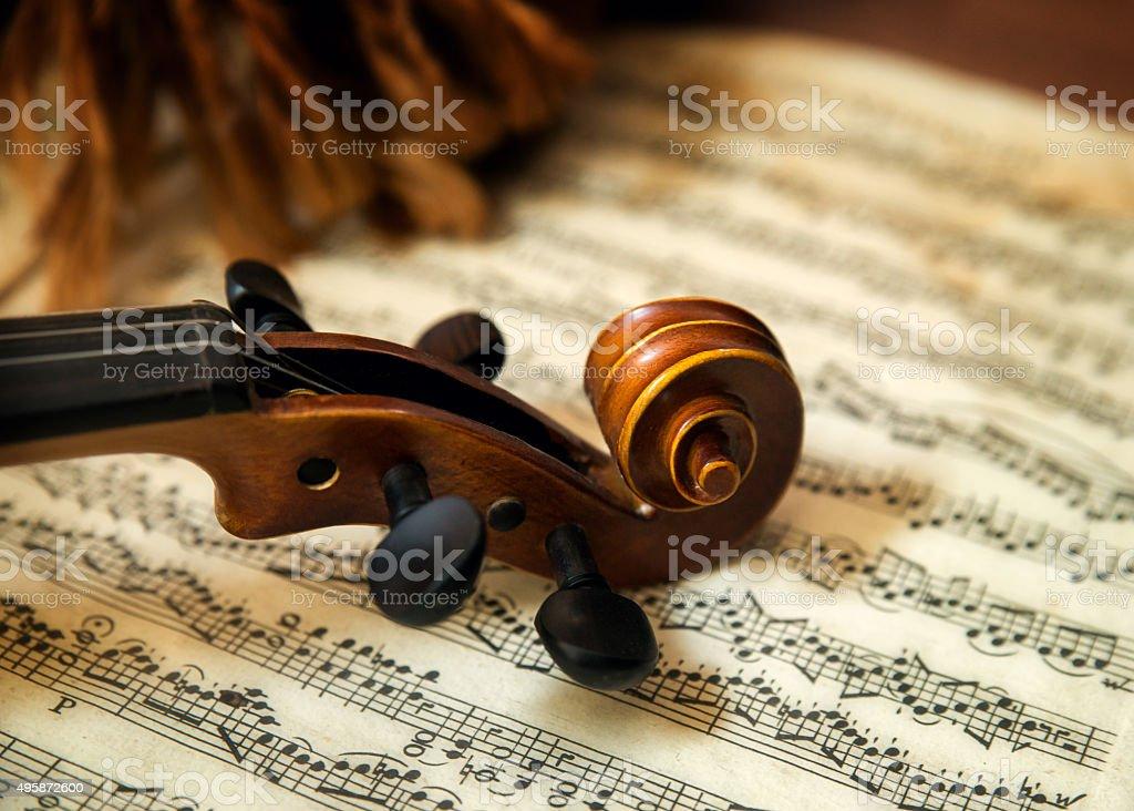 Violin head on sheet music stock photo