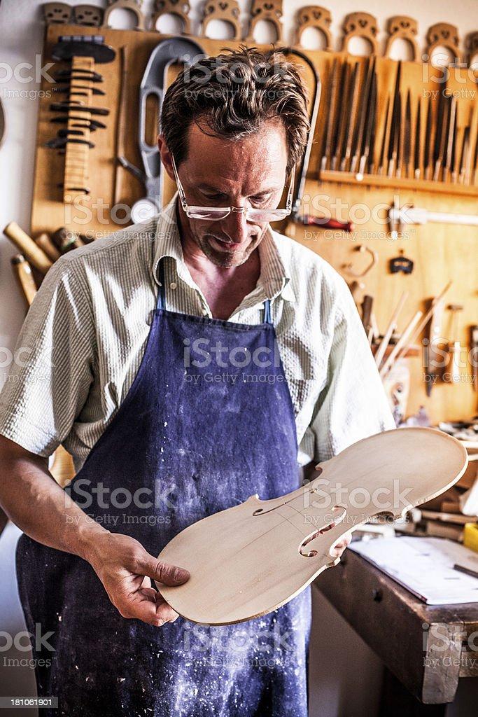 Violin Maker in Cremona, Italy stock photo