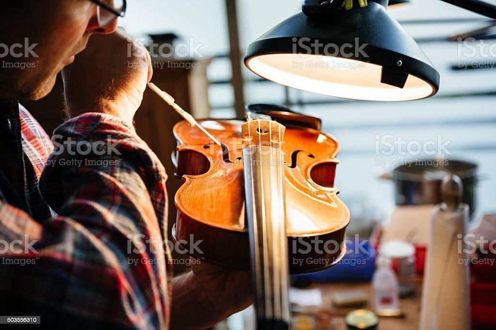 Violin Maker Repairing On Instrument stock photo