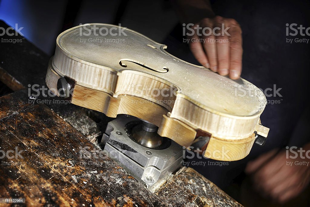 Violin Maker Working on a New Musical Istrument stock photo