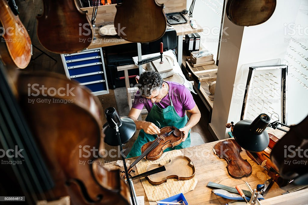 Violin Maker Working On Instrument stock photo