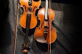 Violin musical instrument on black background