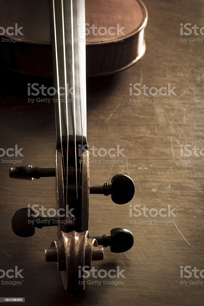 Violin neck on wooden table royalty-free stock photo