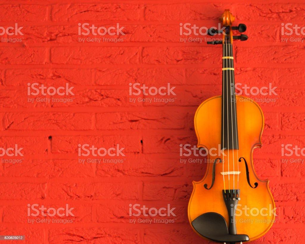 violin on a grunge stone background stock photo