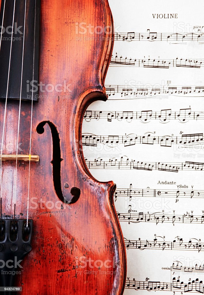 violin on classical sheet music stock photo