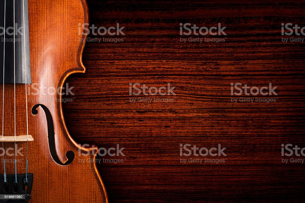 Violin on grunge dark wood background stock photo