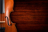 Violin on grunge dark wood background