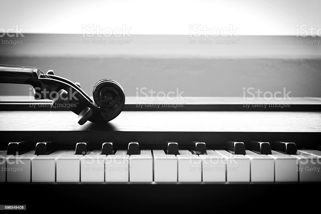 Violin on piano. Black and White color tone. stock photo