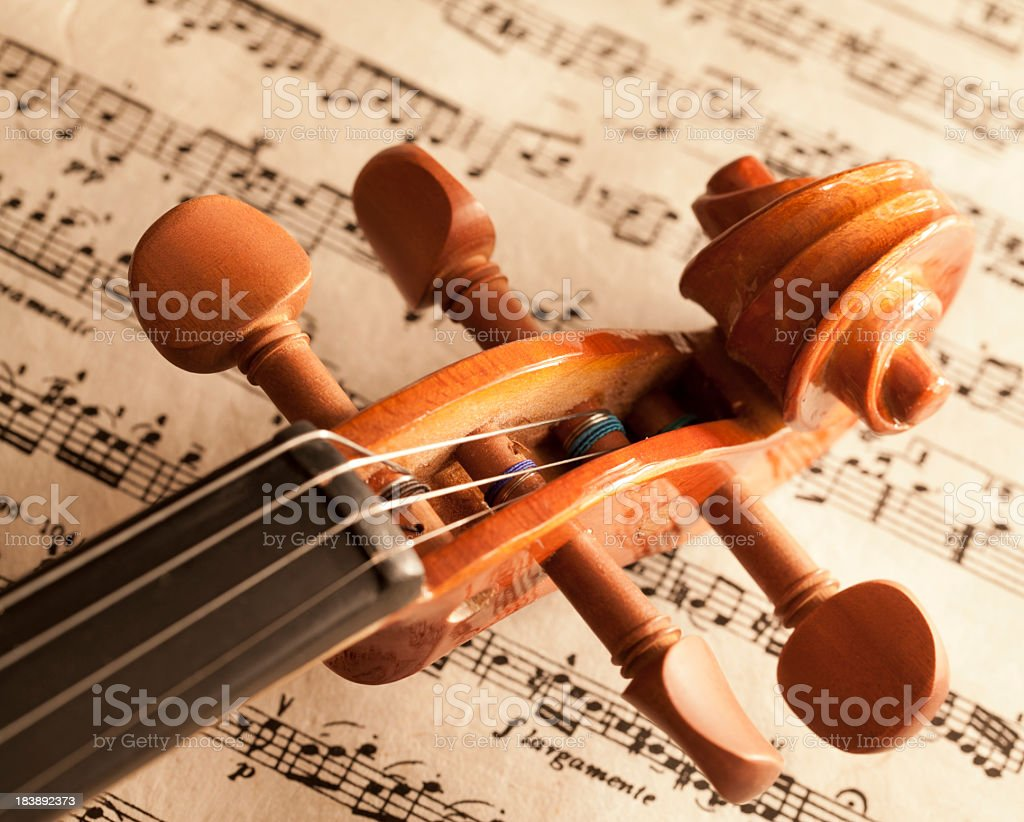 Violin on sheet music stock photo