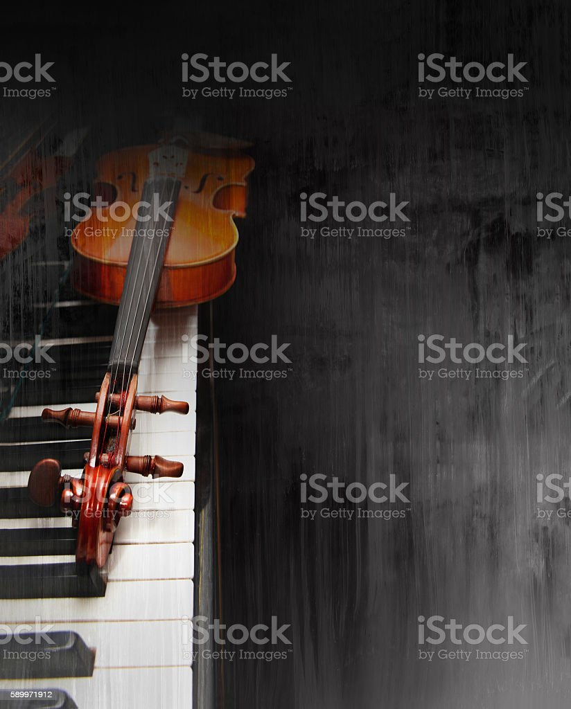Violin on the piano stock photo