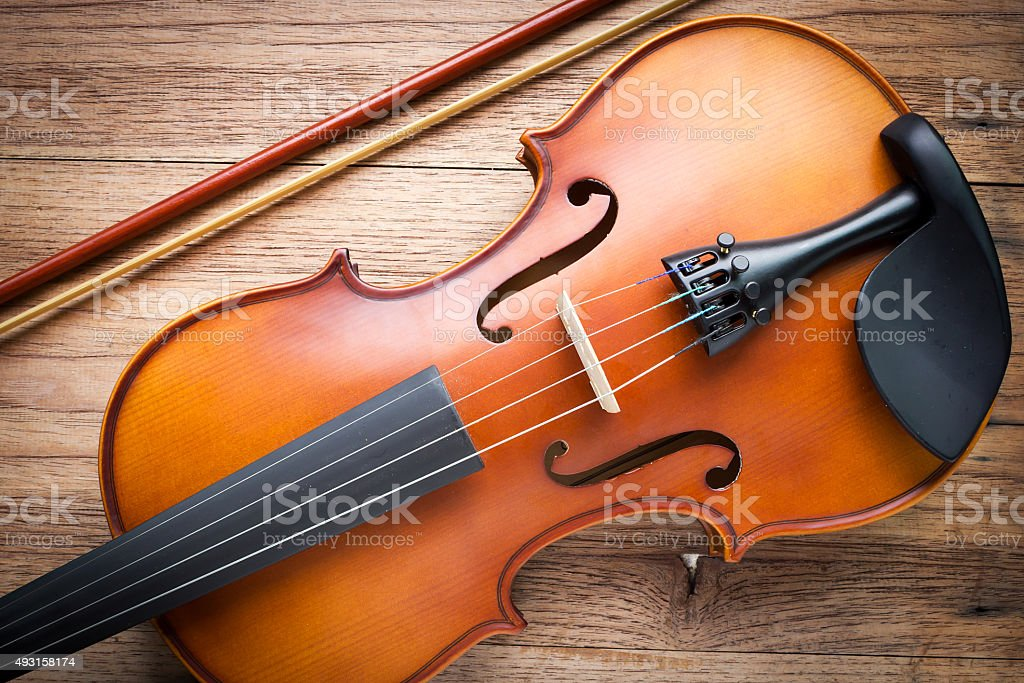 Violin on wood background. stock photo