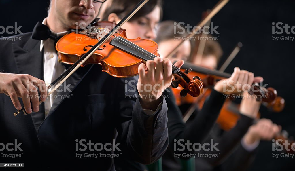 Violin orchestra performing stock photo