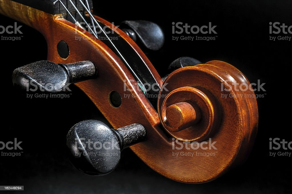 Violin pegbox and scroll detail royalty-free stock photo