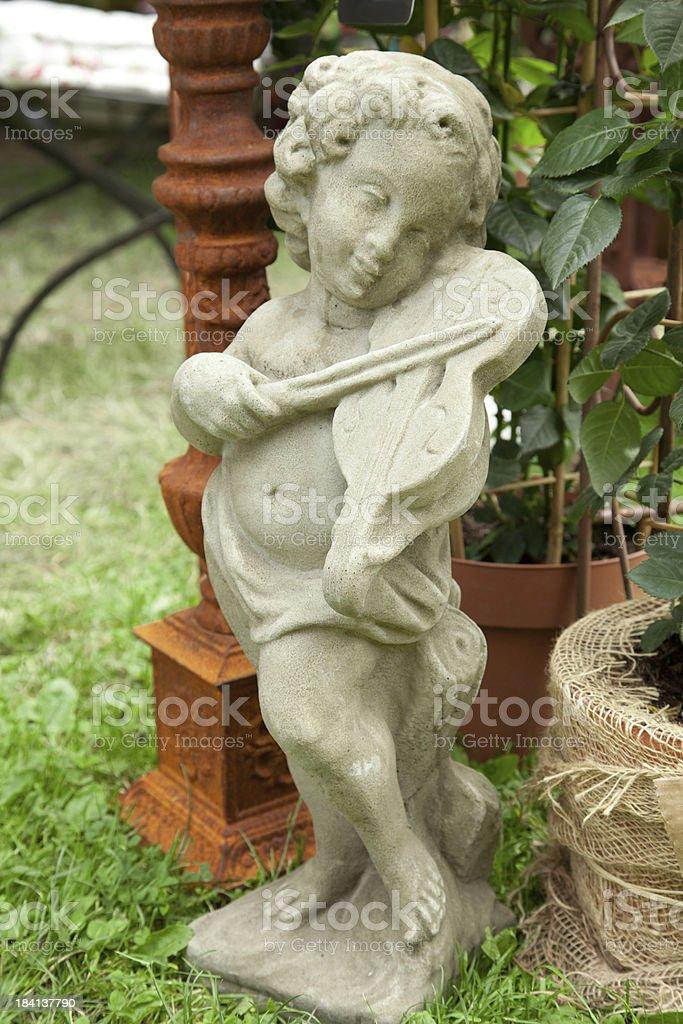 Violin playing cherub stock photo