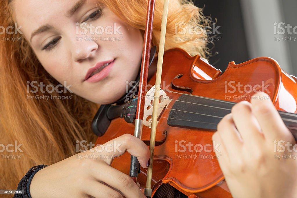 Violin playing stock photo