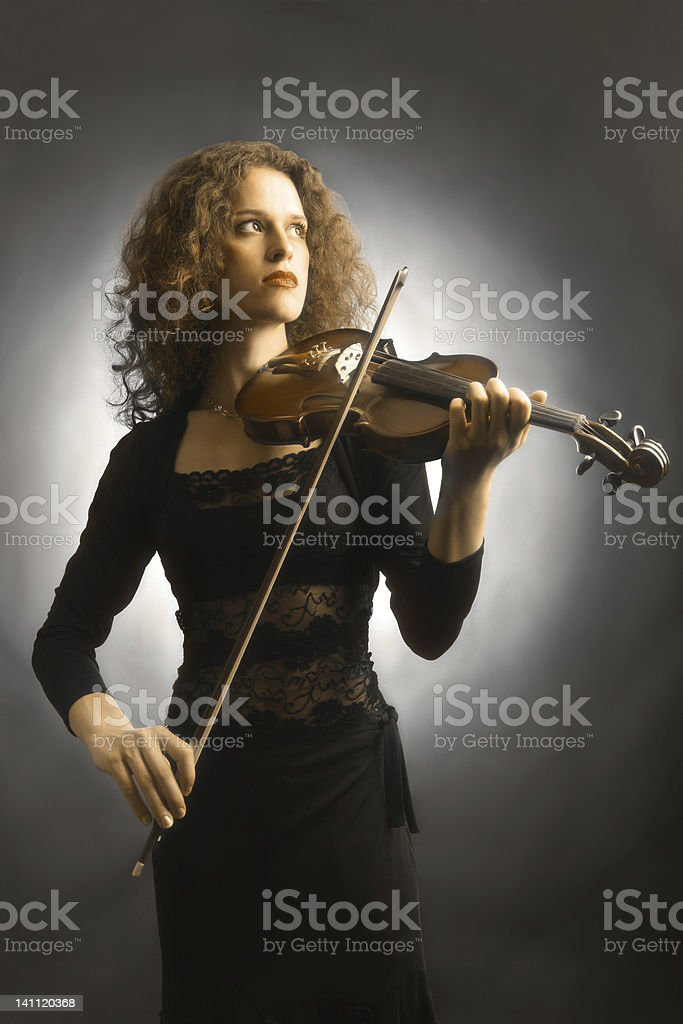 Violin playing violinist musician. stock photo