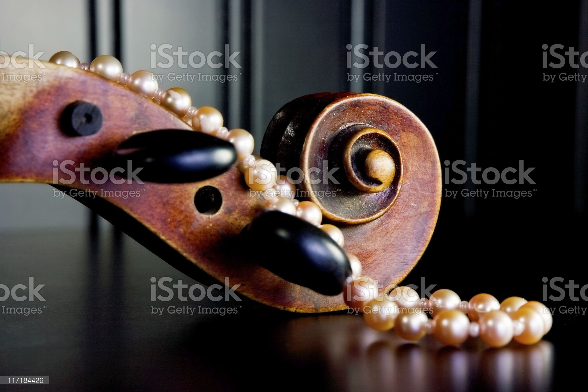 Violin Scroll and Pink Pearls royalty-free stock photo
