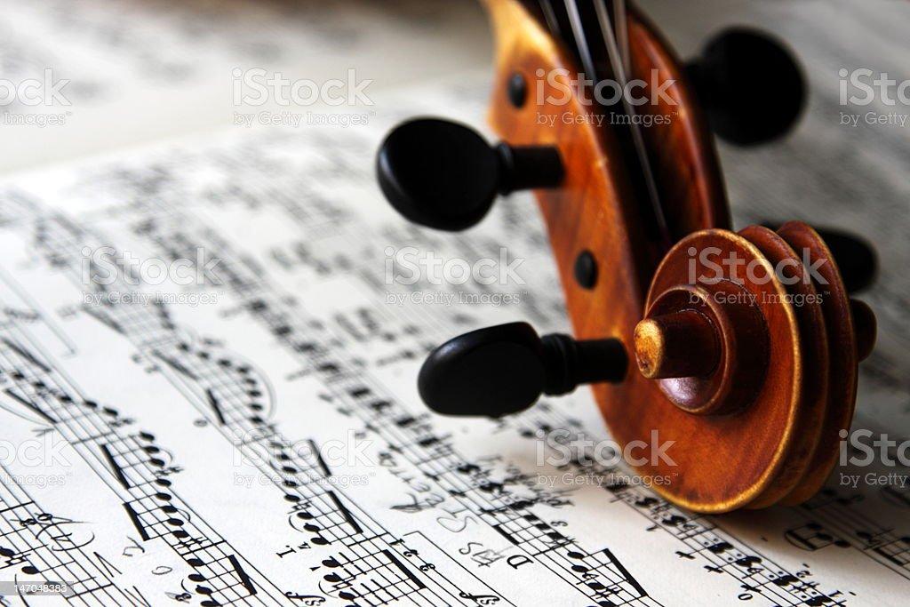 violin scroll and sheet music royalty-free stock photo