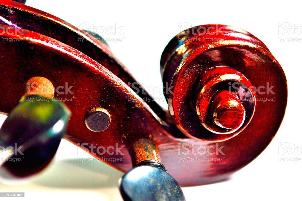Violin scroll in vivid colors stock photo