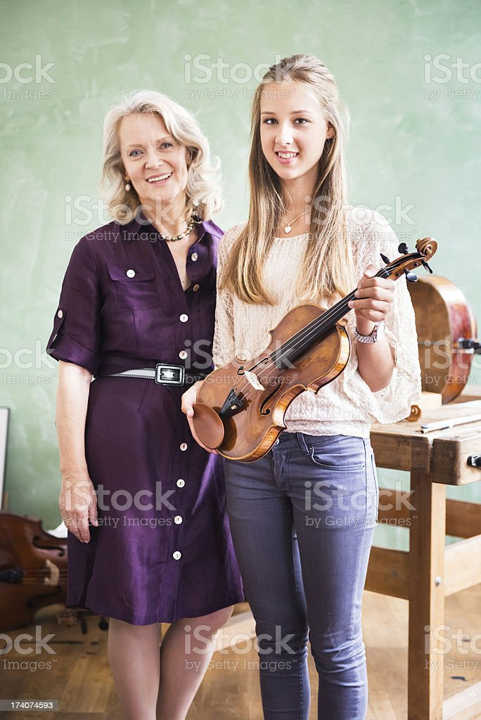 Violin Teacher and Student stock photo
