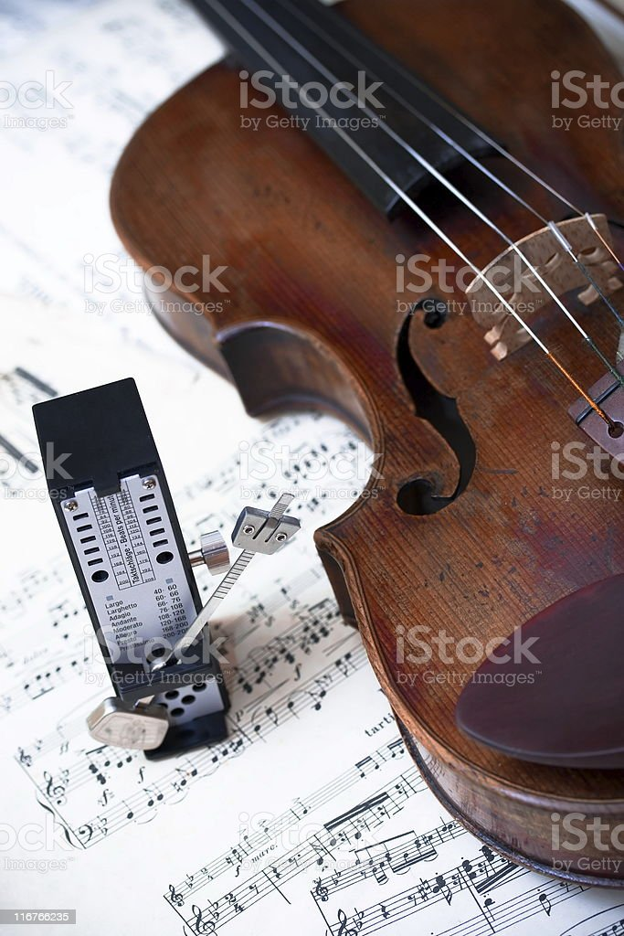 Violin with metronome royalty-free stock photo